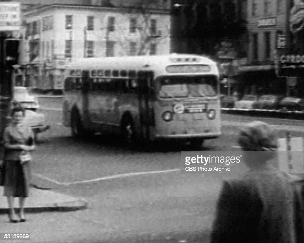 Screen capture shows a bus on the road during the bus boycott in Montgomery Alabama late 1955