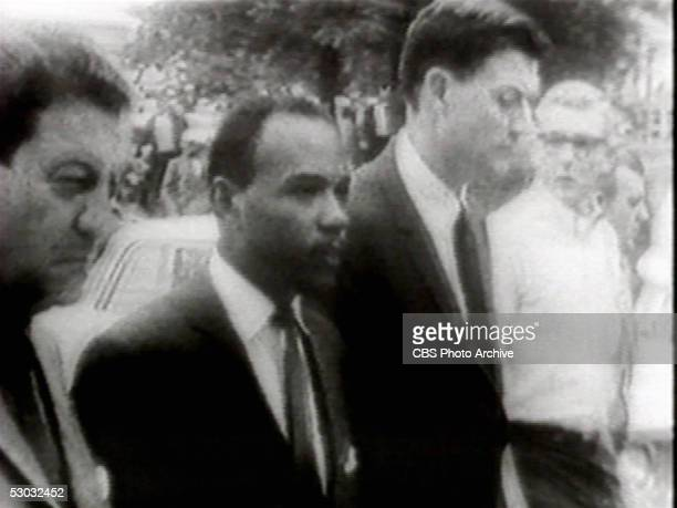 Screen capture shows American college student James Meredith accompanied by US Department of Justice attorney John Doar as he is escorted by federal...