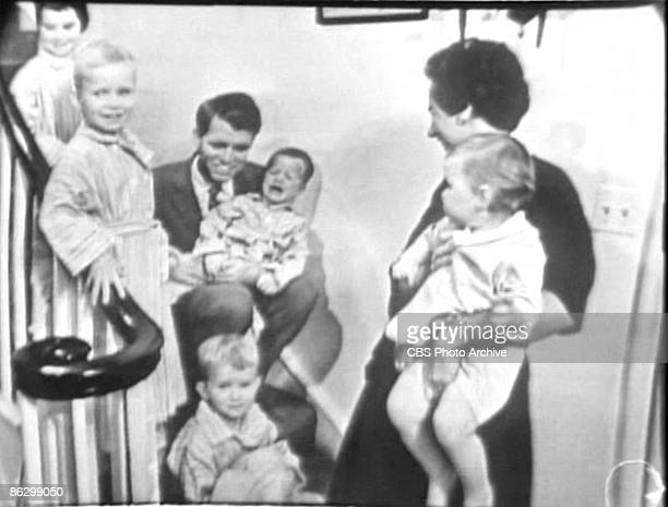 Screen capture shows American politician Robert F. Kennedy , his wife, socialite Ethel Kennedy , and their family on a staircase during an interview...