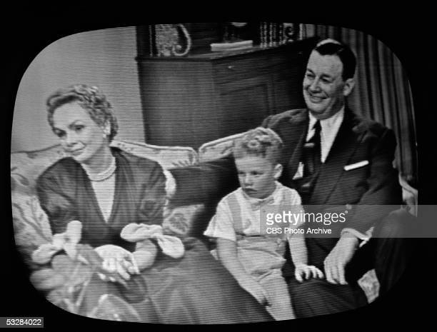 Screen capture shows American restauranteur Bernard Toots Shor and his family at their home during an interview with Edward R Murrow on 'Person to...