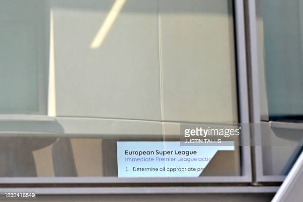Screen display is seen through the windows of The English Premier League's headquarters in west London England on April 20 as football's governors...