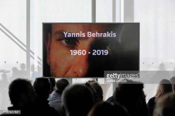 A TV screen displays a photo of the late awardwinning Reuters photographer Yannis Behrakis during his memorial service at the Stavros Niarchos...