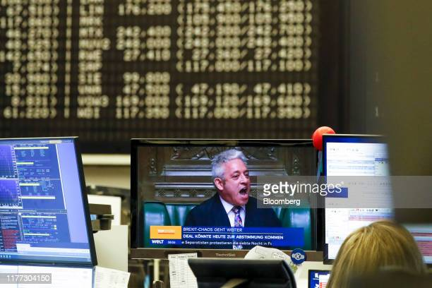 Screen displays a television news report on Brexit as a trader monitors financial data inside the Frankfurt Stock Exchange, operated by Deutsche...