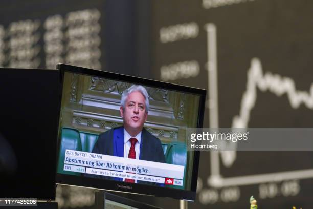 Screen displays a television news report on Brexit inside the Frankfurt Stock Exchange, operated by Deutsche Boerse AG, in Frankfurt, Germany, on...