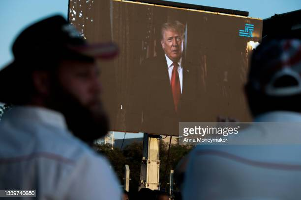 """Screen displays a video message from former U.S. President Donald Trump plays during a """"Let Us Worship"""" prayer service on the National Mall on..."""