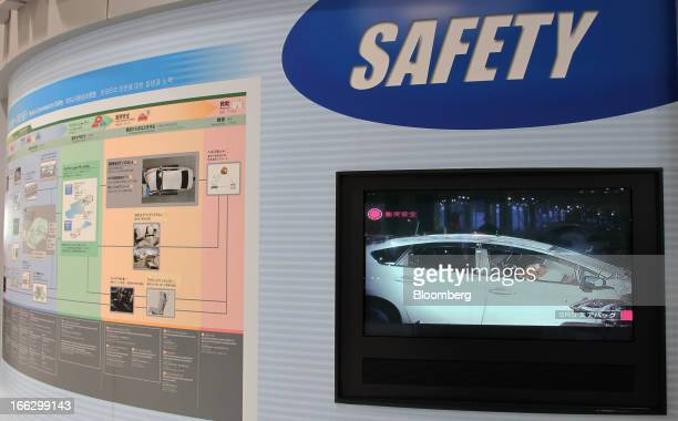A screen displays a video on airbag safety on Toyota Motor Corp vehicles at the company's showroom in Tokyo Japan on Thursday April 11 2013 Takata...