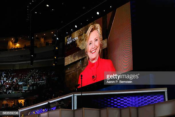 A screen displays Democratic presidential candidate Hillary Clinton delivering remarks during the evening session on the second day of the Democratic...