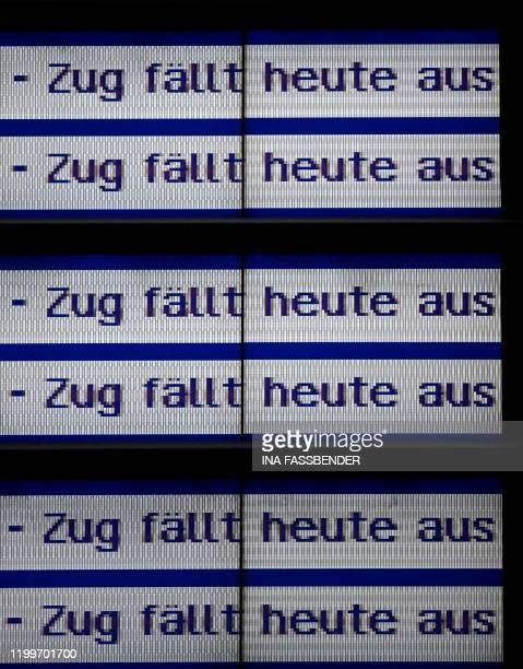 A screen displays informations reading 'train cancelled today' because of the forecasted heavy storm 'Sabine' in Dortmund western Germany on February...