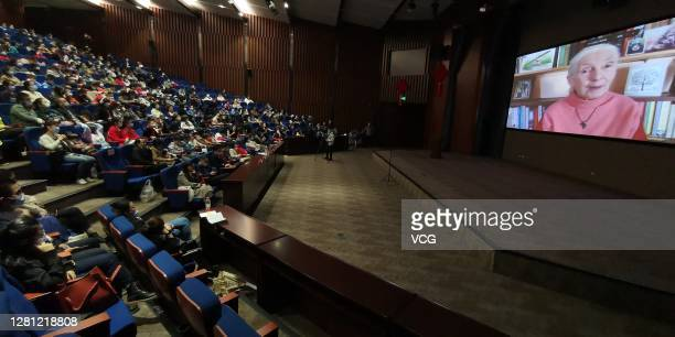 Screen displays Jane Goodall, a primatologist from Great Britain, giving her lecture 'Reasons for Hope' at the Changjiang Civilization Museum on...