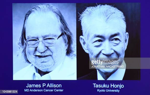 A screen displays portraits of James P Allison and Tasuku Honjo during the announcement of the winners of the 2018 Nobel Prize in Physiology or...