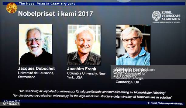 A screen displays portraits of winners of the 2017 Nobel Prize in Chemistry on October 4 2017 at the Royal Swedish Academy of Sciences in Stockholm...