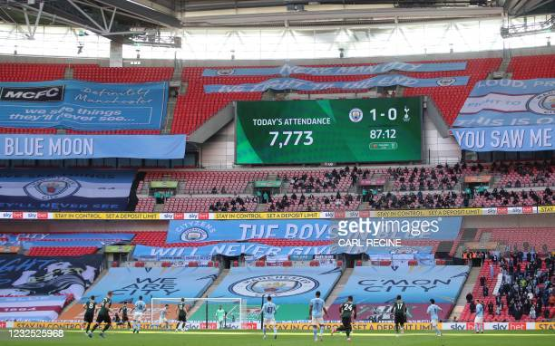 Screen displays the attendance figure of 7,773 spectators during the English League Cup final football match between Manchester City and Tottenham...