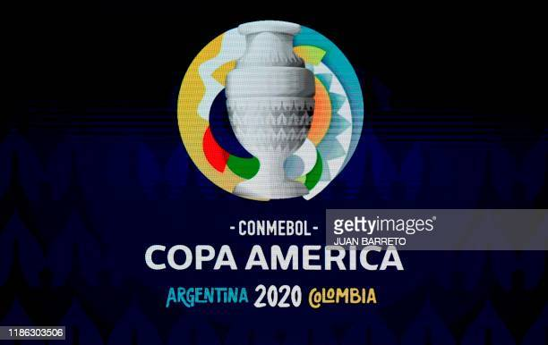 A screen displays the logo of the Copa America 2020 during the draw of the football tournament at the Convention Centre in Cartagena Colombia on...