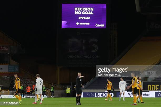 """Screen displays the """"No Goal"""" VAR decision following a review of Leeds United's English striker Patrick Bamford's disallowed goal during the English..."""
