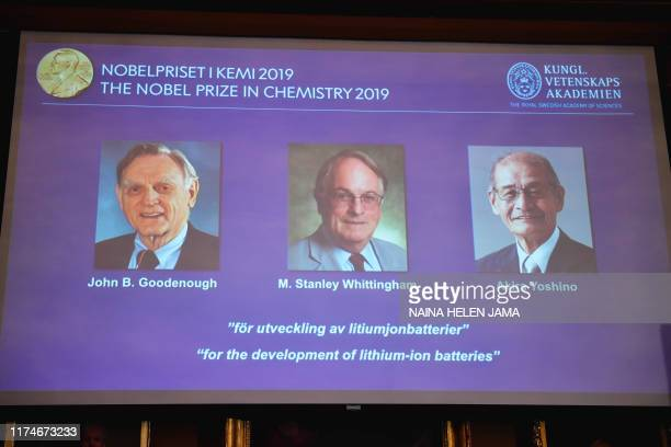 A screen displays the portraits of the laureates of the 2019 Nobel Prize in Chemistry John Goodenough of US Britain's Stanley Whittingham and Japan's...