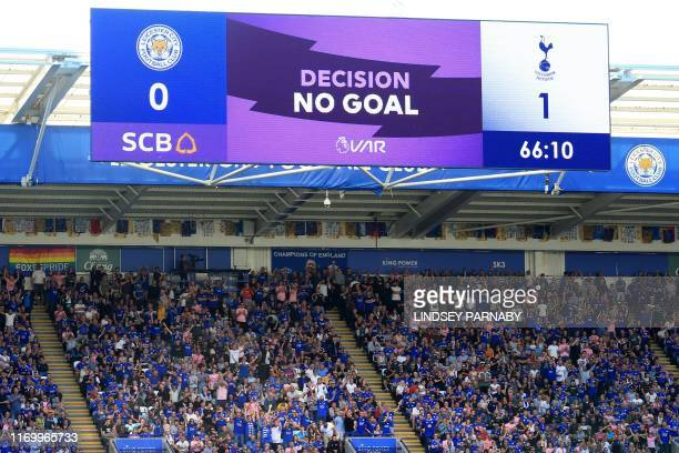 A screen displays the VAR decision to disallow Tottenham Hotspur's Ivorian defender Serge Aurier's goal during the English Premier League football...