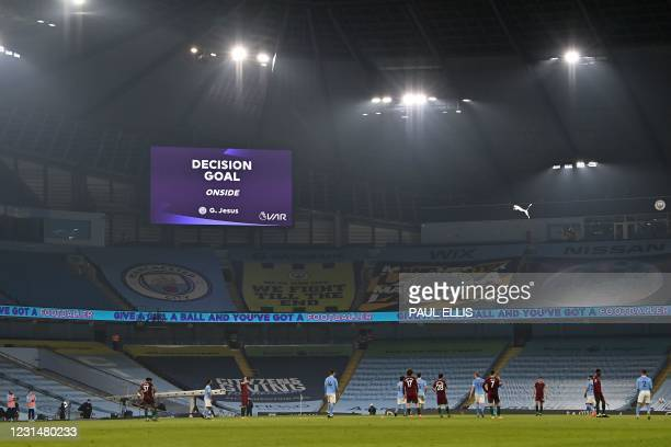 Screen displays the VAR review decision that the fourth Manchester City goal, but Manchester City's Brazilian striker Gabriel Jesus, stands, during...