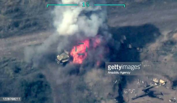 Screen grab captured from a video shared by Azerbaijan Defence Ministry shows Armenian positions being targeted after the launch of a counter then a...