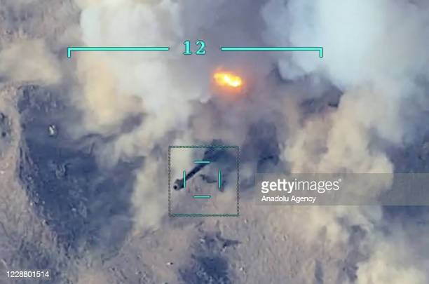 Screen grab captured from a video shared by Azerbaijan Defence Ministry shows Armenian positions being destroyed after the launch of a counter then a...