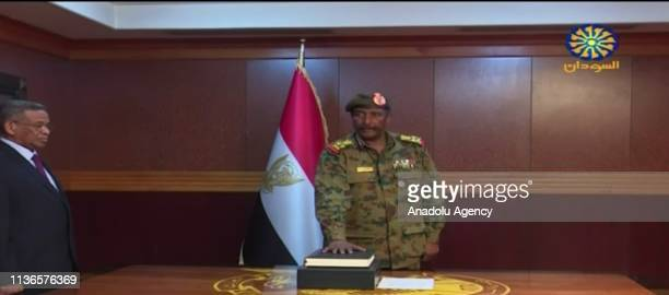 Screen grab captured from a video shows Lieutenant General Abdel Fattah Burhan swearing in as the new head of the transitional military council in...