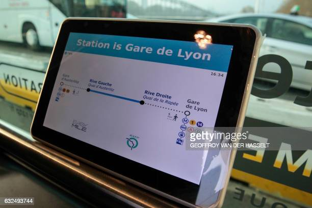 A screen inside a selfdriving bus shuttle between Austerlitz station and Lyon station in Paris produced by Easymile company in Paris is pictured on...