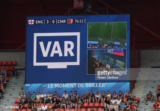 Screen inside the stadium displays a VAR review during the 2019 FIFA Women's World Cup France Round Of 16 match between England and Cameroon at Stade...