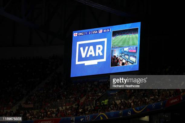 A screen inside the stadium displays decisions of a VAR review during the 2019 FIFA Women's World Cup France Semi Final match between England and USA...