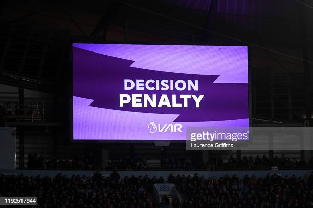 Screen inside the stadium displays the decision to award a penalty following a VAR review during the Premier League match between Manchester City and...