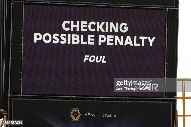 Screen inside the stadium displays the decision to check VAR for a potential penalty during the Premier League match between Wolverhampton Wanderers...