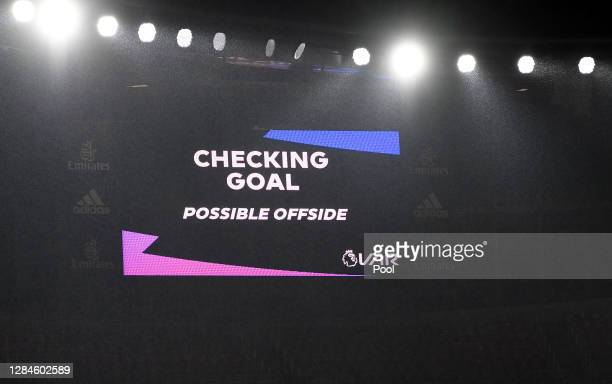 Screen inside the stadium displays the decision to check VAR for offside after John McGinn of Aston Villa scores his team's first goal during the...