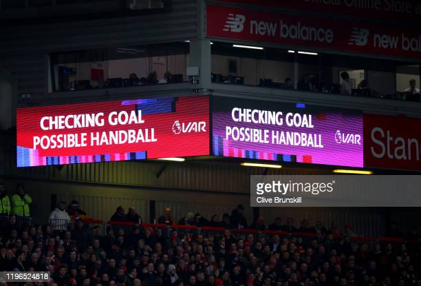 Screen inside the stadium explains to fans that a VAR check is in process before the awarding of Liverpools first goal during the Premier League...
