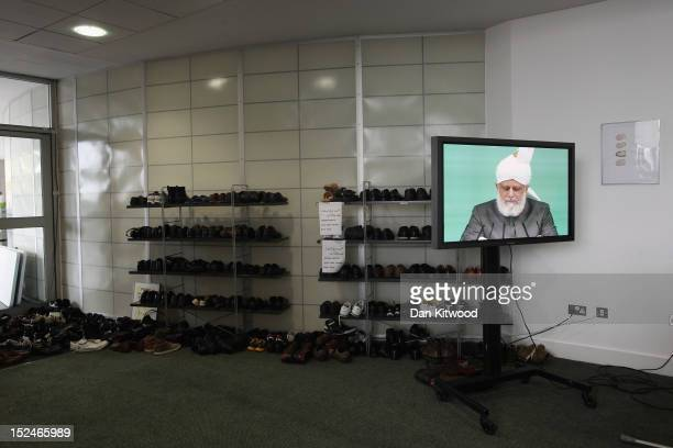 TV screen is displayed as the Islamic Khalifa of the Ahmadiyya Muslim community Mirza Masroor Ahmad speaks at Baitul Futuh Mosque in Morden on...