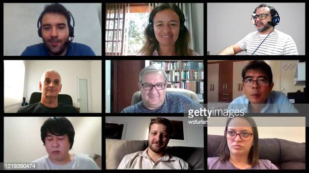 screen of a video conference with nine people. image for paste to your screen. - video conference stock pictures, royalty-free photos & images