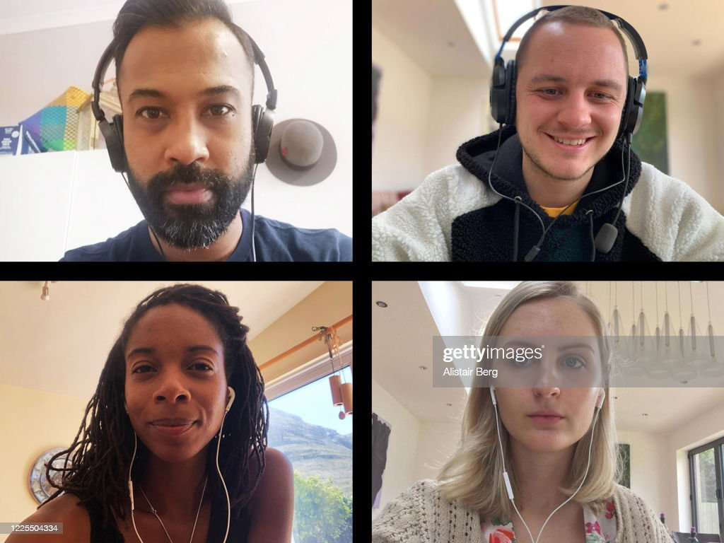 Screen of four friends connecting on video call : Stock Photo