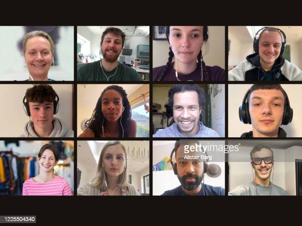 screen of multiple friends socialising on video call - ver stockfoto's en -beelden