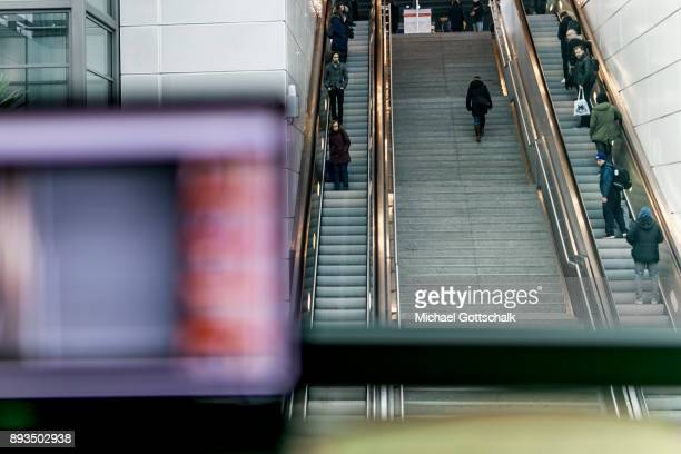 A screen of one of the monitoring systems of a project for automatic recognition of faces is seen in front of the monitoring area at trainstation...