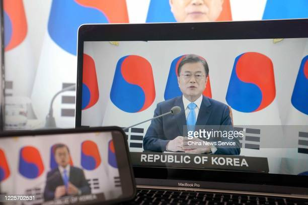 A screen of South Korean President Moon Jaein speaking during the opening ceremony of the 73rd annual World Health Assemble via video conference on...