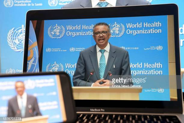 Screen of World Health Organization Director-General Tedros Adhanom Ghebreyesus speaking during the opening ceremony of the 73rd annual World Health...