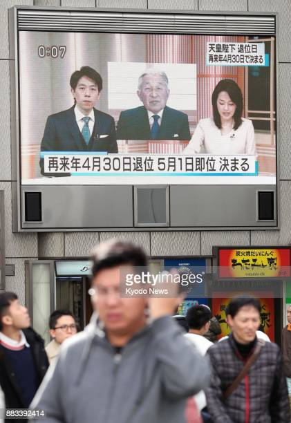 A TV screen on a street in Osaka shows news of the Imperial House Council's meeting on Dec 1 that set Japanese Emperor Akihito's abdication on April...