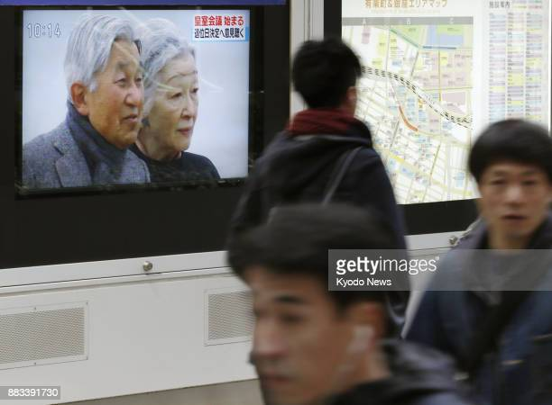A TV screen on a street in Tokyo shows news of the Imperial House Council's meeting on Dec 1 that set Japanese Emperor Akihito's abdication on April...