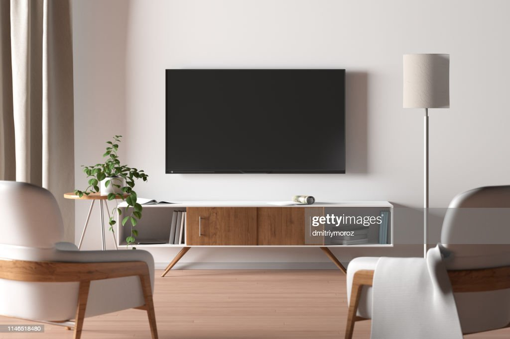 TV screen on the white wall in modern living room. : Stock Photo