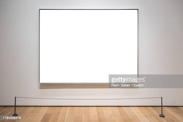 screen on wall - florin seitan stock pictures, royalty-free photos & images
