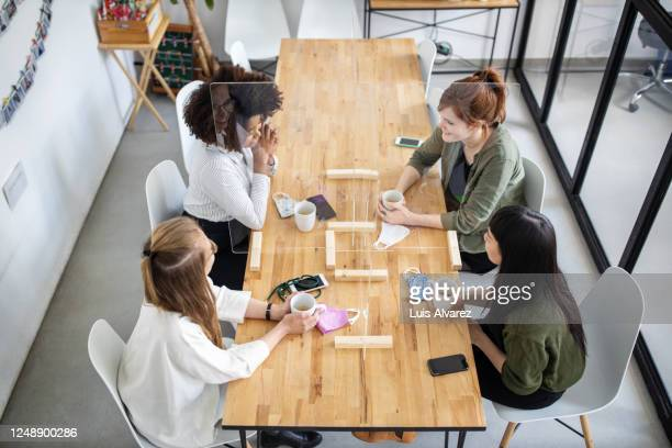 screen partitions on office cafeteria table with employees having coffee - distant stock pictures, royalty-free photos & images