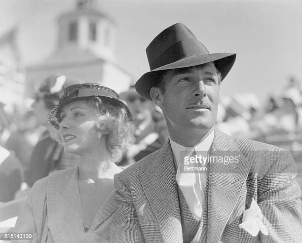 Screen Players View Air Races Los Angeles California Randolph Scott and Vivian Gaye film players seen as they watched the second day's events of the...
