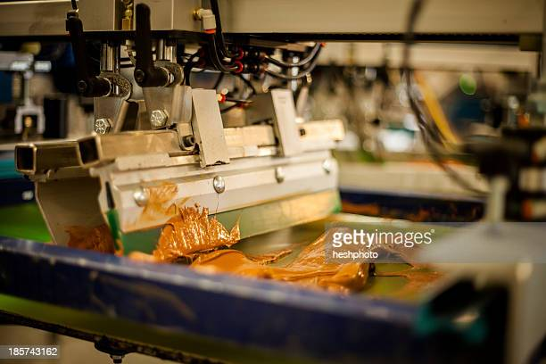 screen print machine spreading ink on frame - heshphoto stock pictures, royalty-free photos & images