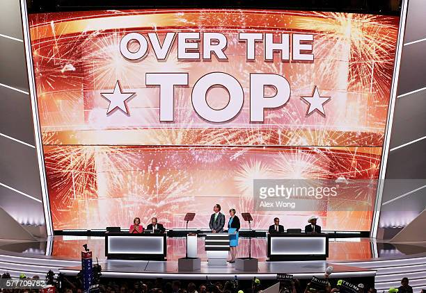 A screen reads 'Over The Top' after Republican presidential candidate Donald Trump received the number of votes needed to secure the party's...