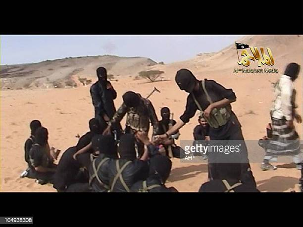 A screen shot of a video posted on the Interenet on October 6 2010 shows militants from AlQaeda in the Arabian Peninsula AlQaeda militants threatened...