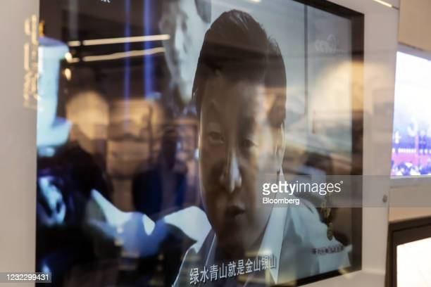 Screen showing a video of Chinese President Xi Jinping during his visit to the region in 2005 inside an exhibition hall at Yucun Village, Anji...