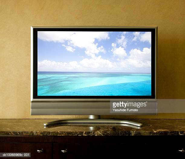 tv screen showing seascape (digital composite) - flat screen stock pictures, royalty-free photos & images