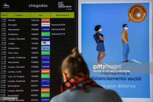 Screen showing the arrival of several flights from the United Kingdom scheduled for today is pictured at Faro airport in Algarve, south of Portugal,...